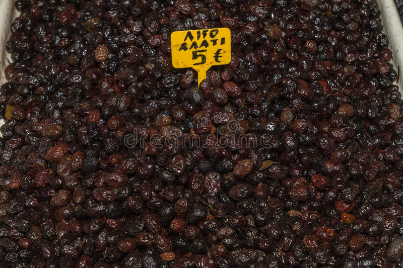 Wrinkled partially salted greek black olives. stock photography