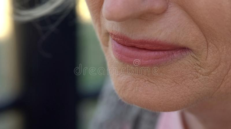 Wrinkled skin around mouth close up, plastic surgery, treatment of aging signs stock photos