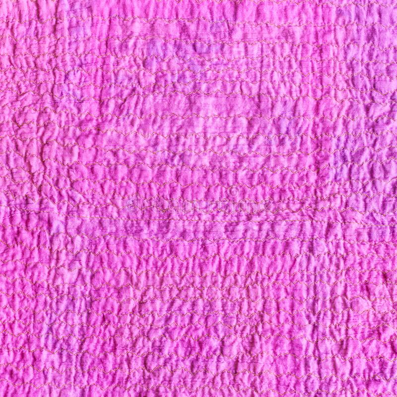 Wrinkled surface of scarf from crushed pink fabric. Textile square background - wrinkled surface of scarf stitched from crushed pink cotton fabric stock photos