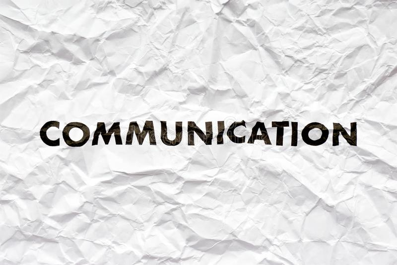Wrinkled white paper with the word communication stock image