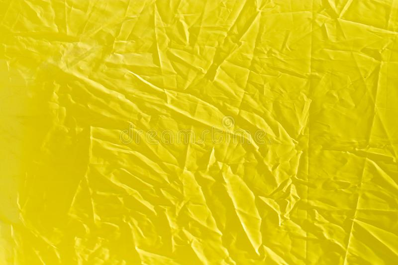 Wrinkled yellow cloth as background stock photo