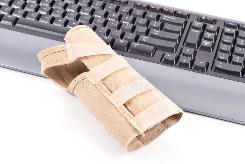 Wrist Brace. On Computer Keyboard royalty free stock images