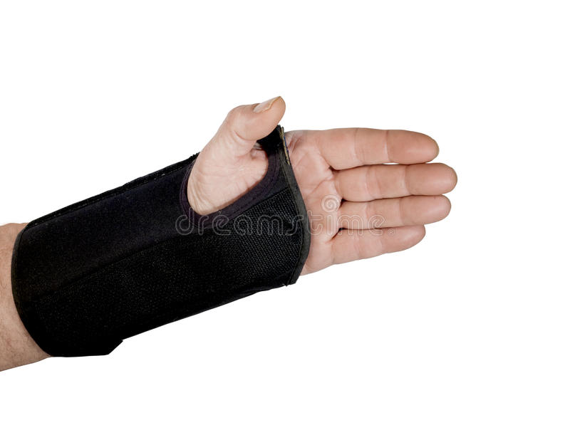 Wrist brace. Mans wrist in a brace with clipping path at original size stock photos