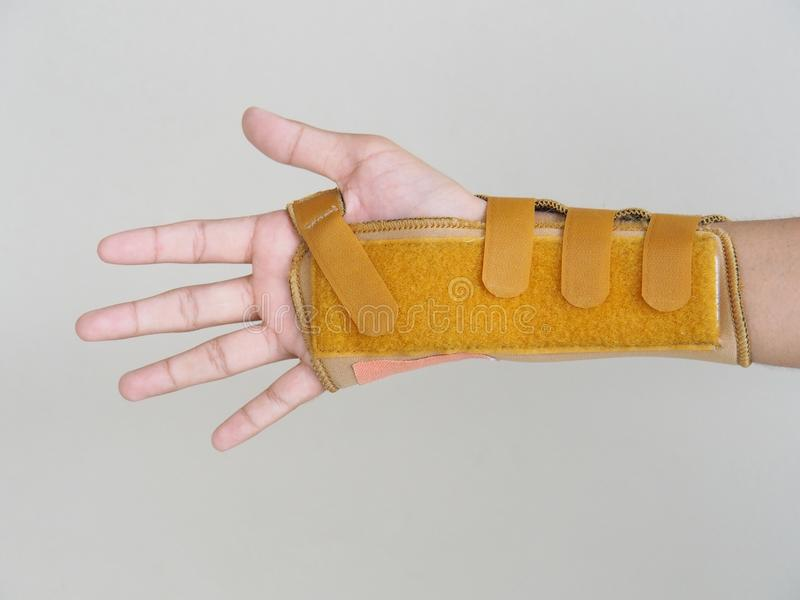 Wrist-Brace-with-Splint Put on the right arm of the boy. After he broke his arm with an accident. stock photo