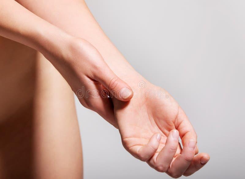 Wrist pain symptomatic stock image