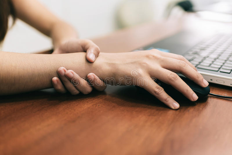 Wrist pain from using computer stock photo
