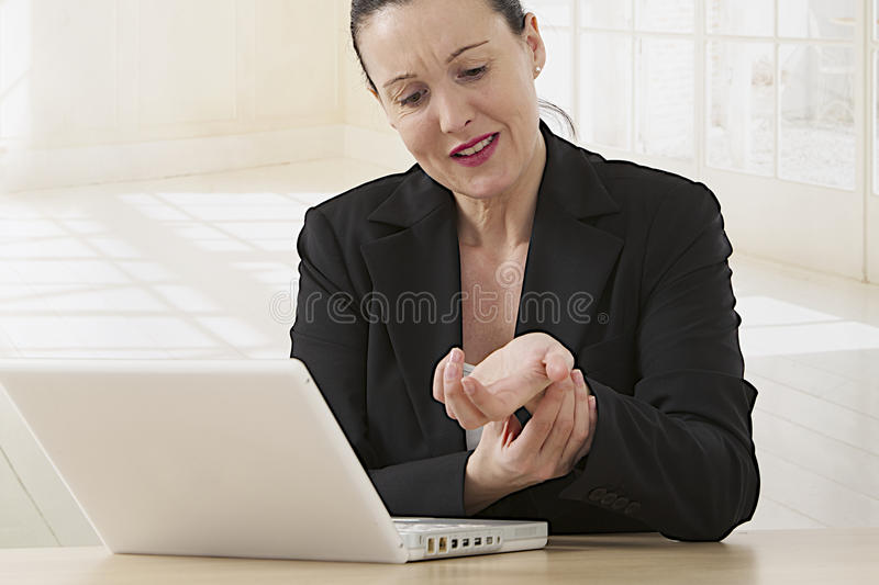 Wrist pain after working on computer royalty free stock photo