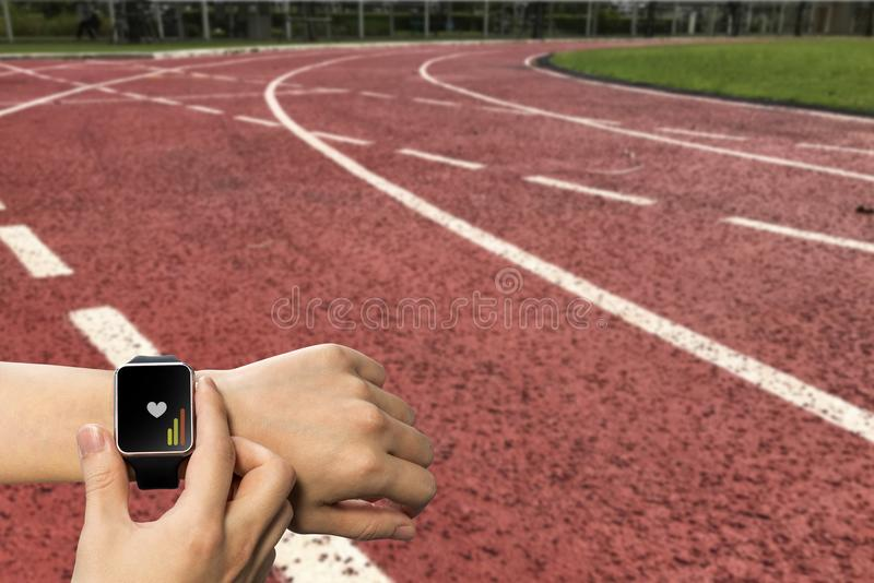 Wrist shot of athletic man or woman on running track stock image