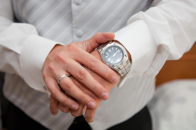 Wrist-watch. Male hands and wrist-watch royalty free stock images