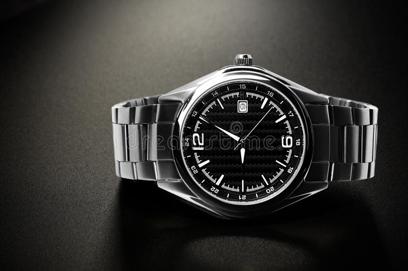 Wrist watch. Titanium wrist watch with black dial. Black background stock images