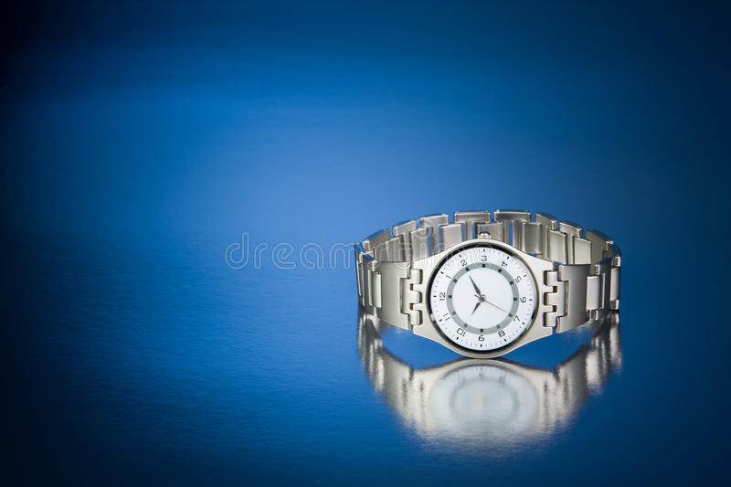 Wrist Watch. On a blue reflective background royalty free stock photo