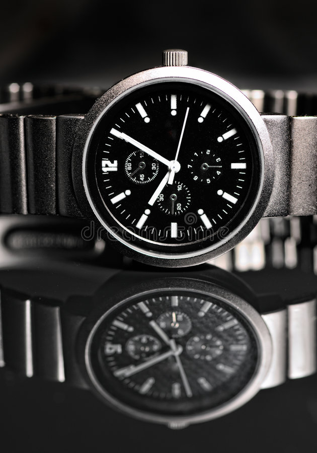 Wrist watch. Men's wrist watch on black background. Studio shoot royalty free stock images
