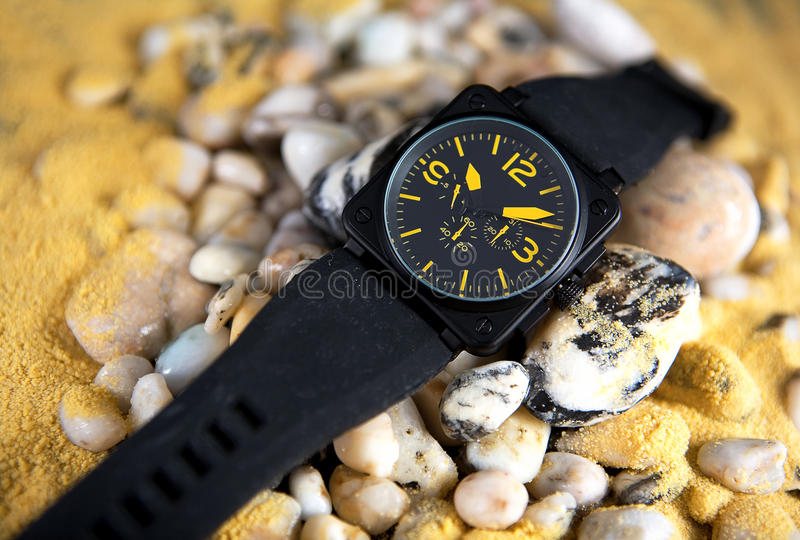 Wrist watch. On pebbles and sand isolated stock photo