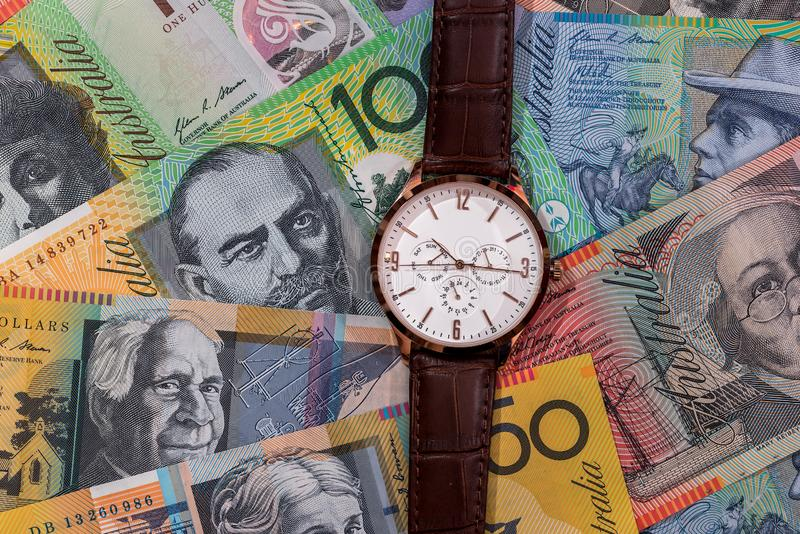 Wrist watch on australian dollars banknotes. As background stock image