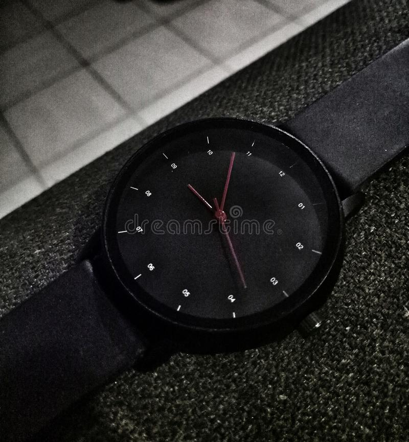 Wrist watch black rubber strap. Fashion wear royalty free stock images