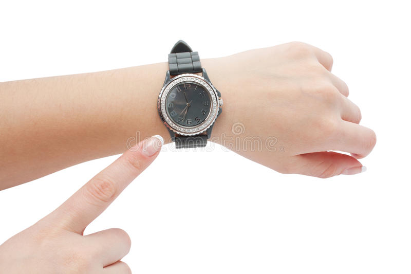 Wrist watch and the hand as a pointer stock photography