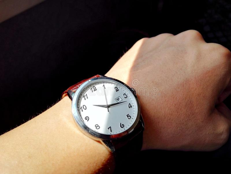 Wrist watch on hand. Insulated, object over white, with absolutely black a background stock images