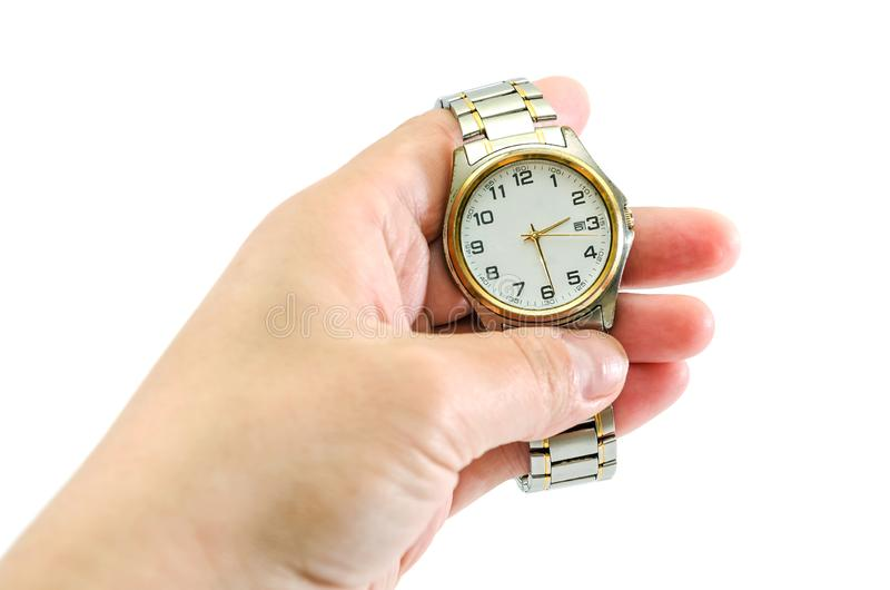 Wrist watch in hand on white background stock photos
