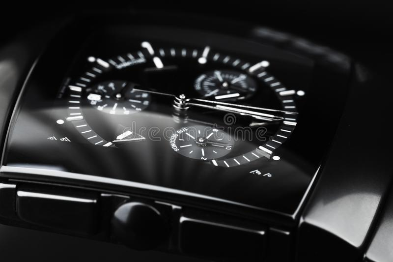 Wrist watch made of black ceramics. Close-up. Studio photo with selective focus stock photography