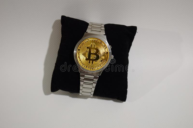 Wrist watch screen bitcoin. Crypto, Concept business, idea: time to earn, buy or sell bitcoin stock photo