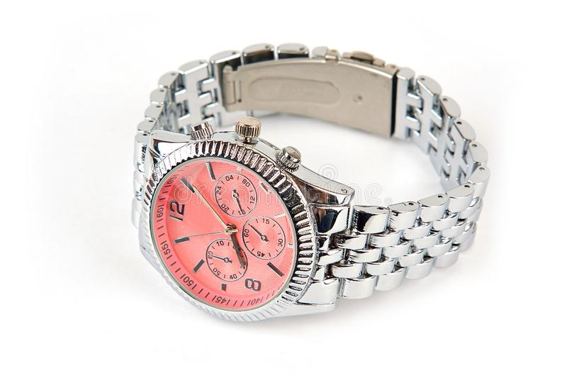 A wrist watch of silver color with a red dial. On a bracelet on a white isolated background royalty free stock photos
