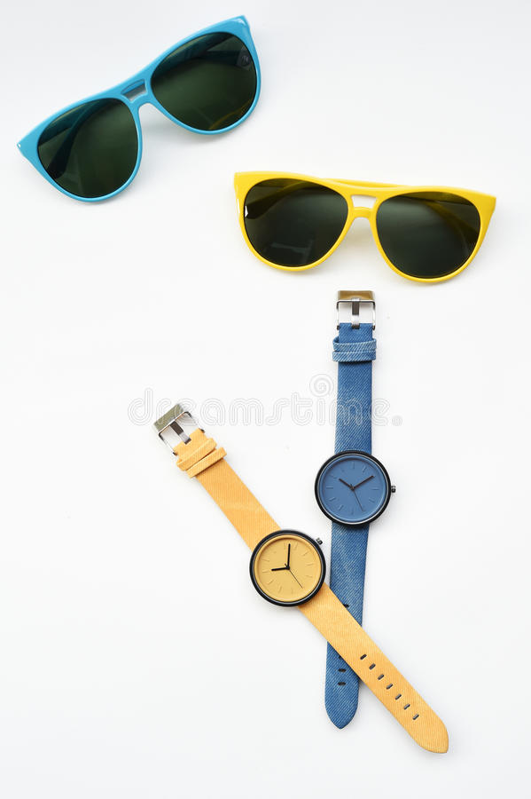 Wrist watch and sunglasses stock image