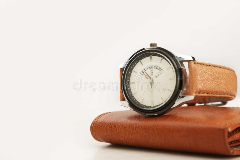 Wrist watch and wallet for men. Isolated on white background stock images