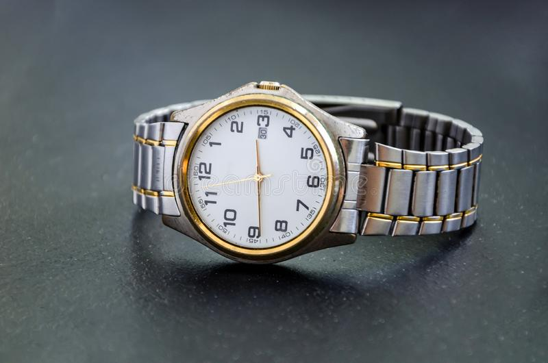 Wrist watches for men on a black background. Close-up. stock photos