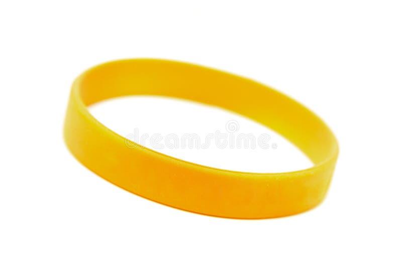 Wristband del silicón, pulsera en el blanco imágenes de archivo libres de regalías