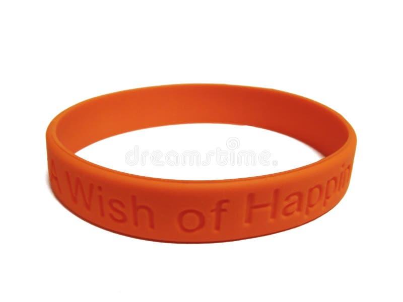 Wristband orange de silicones photos stock