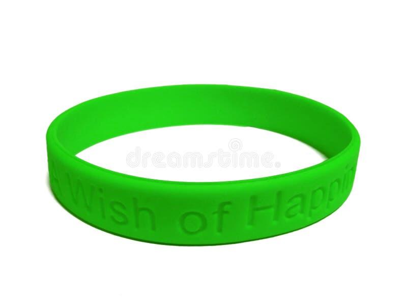 Wristband vert de silicones photos stock