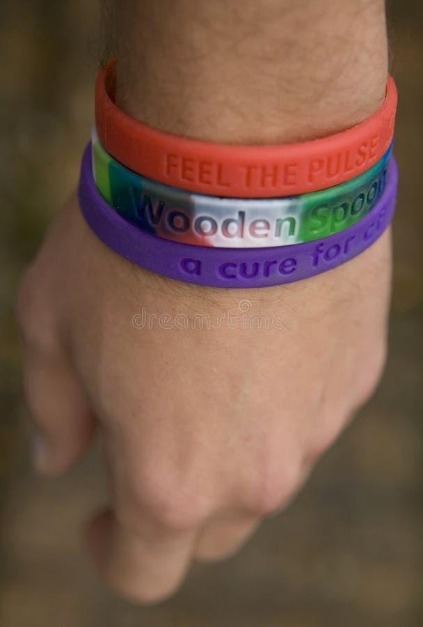 Wristbands da caridade foto de stock