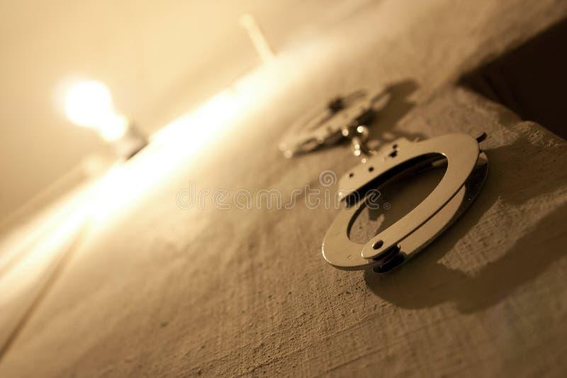 Wristbands na parede da prisão fotografia de stock