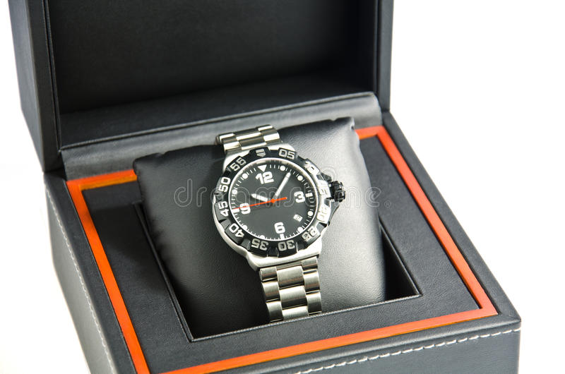 Wristwatch in the box. Men's wrist watch. Time is precious, do not let go stock photos