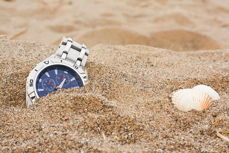 Lost wrist watch at the beach royalty free stock image