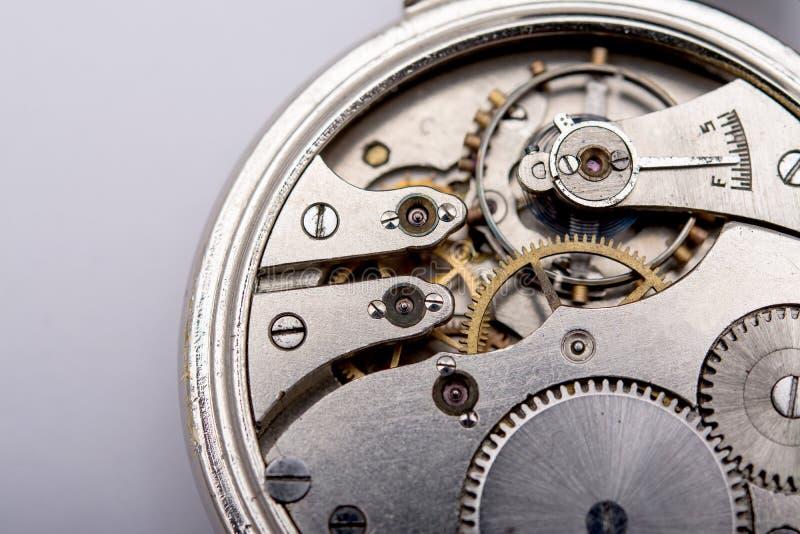 Wristwatch mechanism. Metal Cogwheels in Clockwork mechanism royalty free stock image