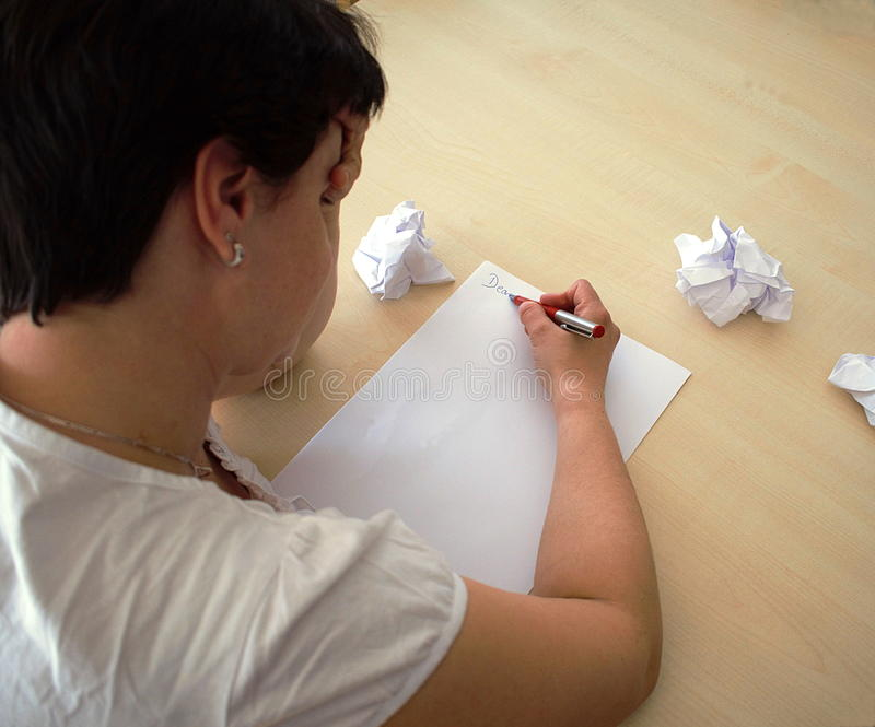Write a letter. Girl write a Letter on a Tabel royalty free stock images