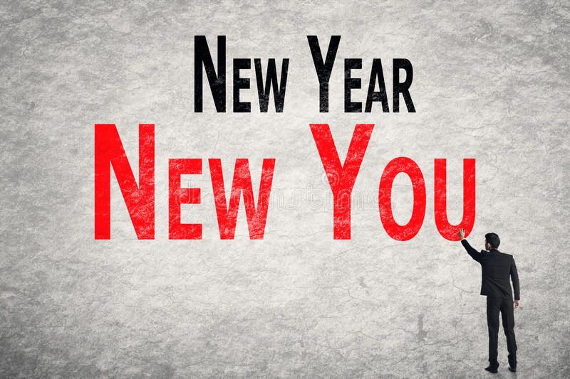 Write words on wall, New Year New You stock photo