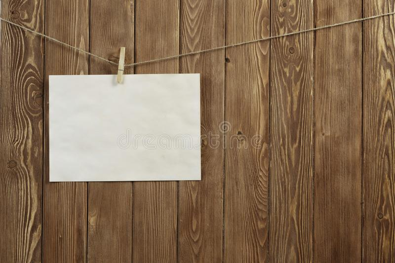 Write your message. Blank sheet of paper hanging on rope royalty free stock photos