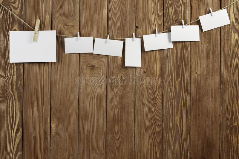 Write your message. Blank sheets of paper hanging on rope royalty free stock image