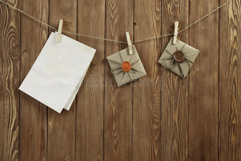 Write your message. Blank sheets of paper hanging on rope stock images
