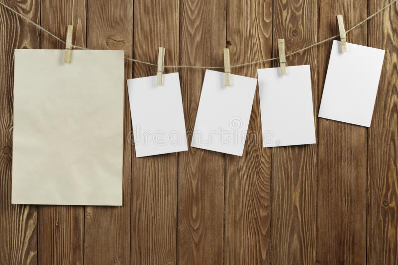 Write your message. Blank sheets of paper hanging on rope royalty free stock photos