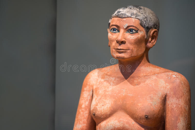 The writer Antique egyptian statuette close up. Beautiful art statuette form ancient egypt the scriba royalty free stock image