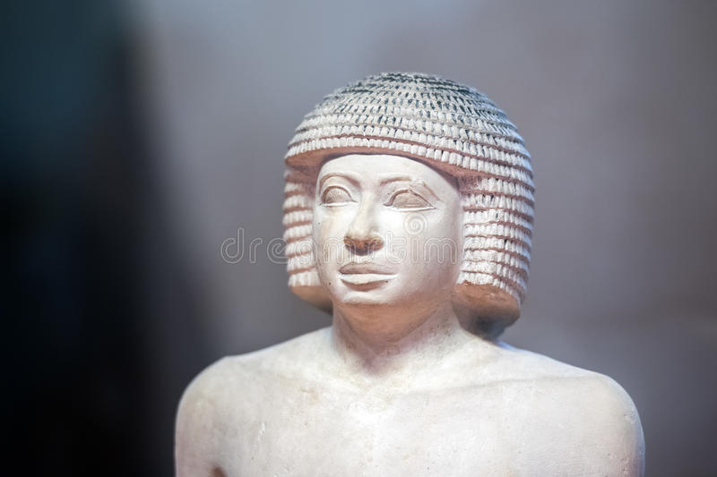 The writer Antique egyptian statuette close up. Beautiful art statuette form ancient egypt the scriba stock photo