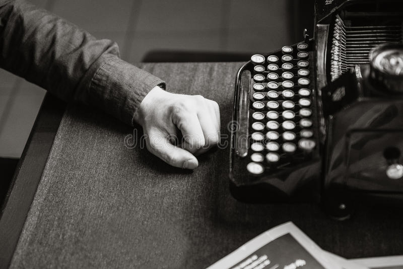 Writer for the old typewriter stock images