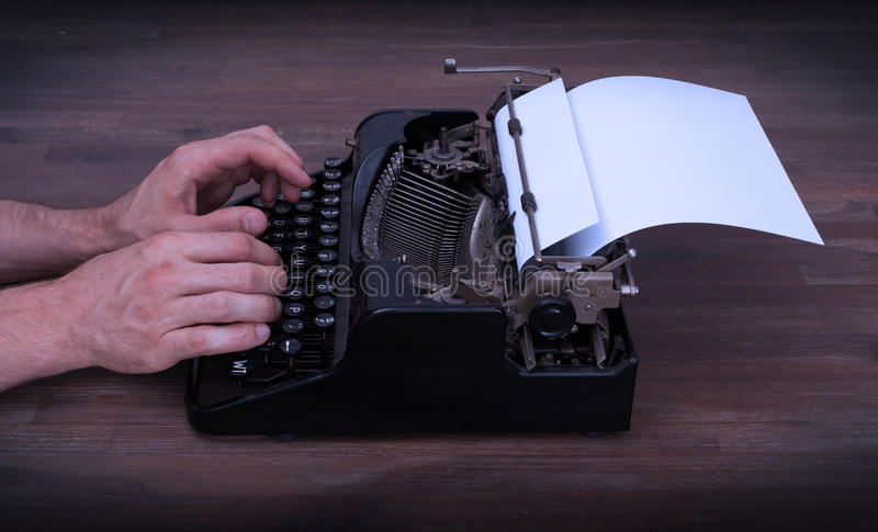 Writer or reporter behind the typewriter. In retrostyle royalty free stock image