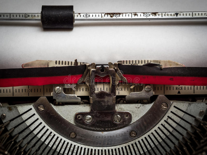 Writer's block. Blank piece of paper in typewriter stock photography