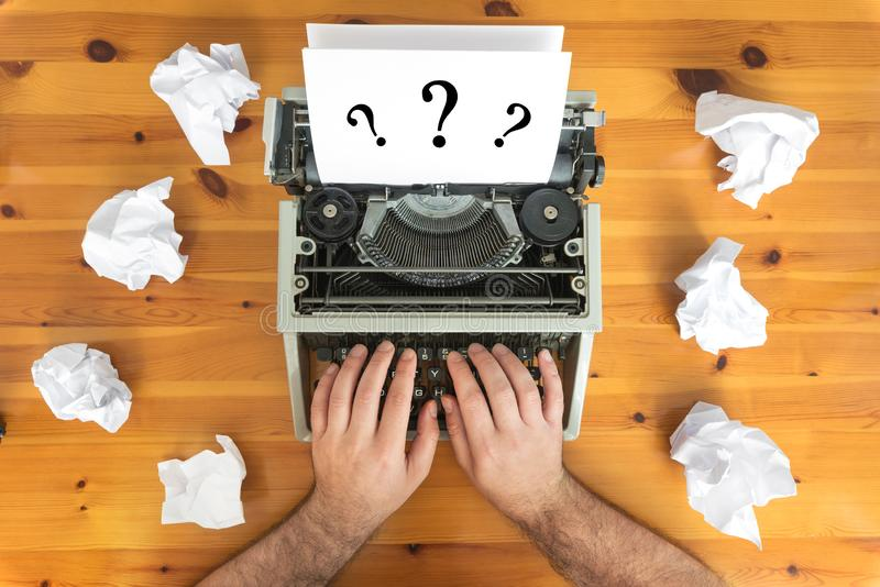 Writer`s block. Typewriter and crumpled paper on work desk. Creative process concept stock image
