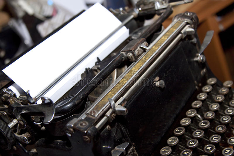 Writer`s typewriter. With a white blank sheet of paper stock photos