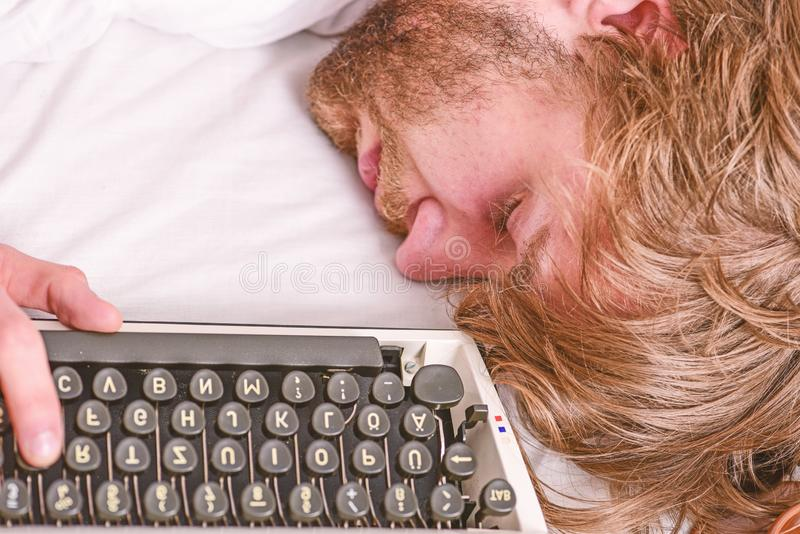 Writer used old fashioned typewriter. Author tousled hair fall asleep while write book. Workaholic fall asleep. Man with. Typewriter sleep. Deadline concept royalty free stock photography
